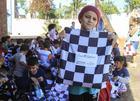 As crianças receberam os kits pela 'Educação e Cultura e Sorria para o Rally' (Luciano Santos/SigCom)